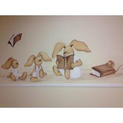 Tres conejitos leyendo